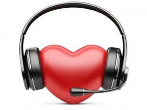 The symbol of a heart wearing a headset.