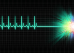 A line on a monitor with the rhythm of a beating heart. The line ends in a flat line towards the Light.